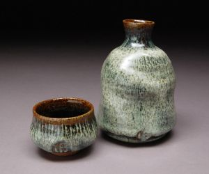Nuka Glaze Recipe, ∆10 reduction      Custer Feldspar    36.00     Quartz   30.00     Whiting   22.00     OM-4   6.00     Wood Ash (unwashed)   3.00     Talc   2.00     Bone Ash   2.00  Notes: This a ∆10 Reduction glaze that will fire to a Creamy White with low gloss to satiny finish. Good over tenmoku, will run if applied too thick over thick tenmoku. As always, test for your ingredient and firing conditions.