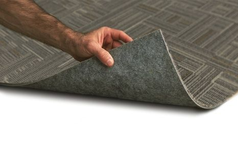TractionBack® modular carpet backing method by Milliken is less costly, environmentally superior and faster and easier to use compared to we adhesives or peel and stick adhesives for modular carpet tile.