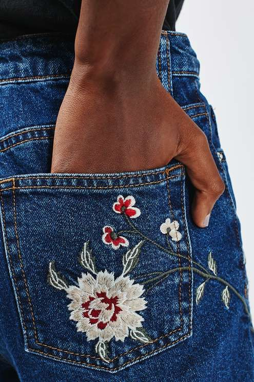 Take florals into the next season in these cool AW16 denim wash high waisted mom jeans in dark blue, featuring cool embroidery on the legs and rolled up hems. #Topshop: