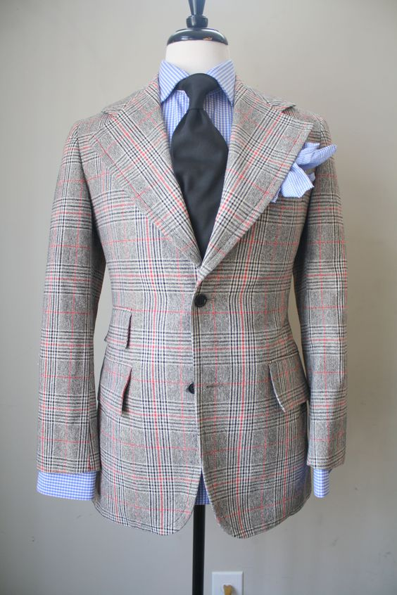 Think the lapels & the PS are both excessive but do like the colours & pattern of the jackets cloth !