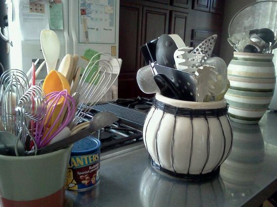 Kitchen utensils in pots? So cool.