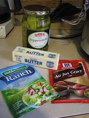 Mississippi Roast - - Put chuck roast in crock pot, Sprinkle with Hidden Valley ranch dressing, add McCormick Au Jus mix, a stick of butter, 5 pepperoncini peppers. DO NOT ADD WATER. Cook on low for 7-8 hrs