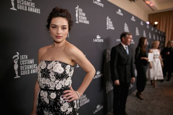 Crystal Reed wearing an M.C.L. by Matthew Campbell Laurenza bracelet to the 16th Costume Designers Guild Awards at The Beverly Hilton Hotel in Beverly Hills, California, 2014