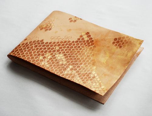 DIY leather sketchbook with honeycomb pattern. Brown and gold and leather and lovely.