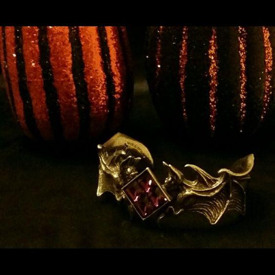 **SALE** Alchemy Gothic Bird of Prey Bat Bracelet Alchemy Gothic 'Bird of Prey' bracelet with four purple Swarovski crystals. Stunningly detailed bats on either side of four diamond cut amethyst Swarovski crystals. Bring out your darker side in an elegant yet bold way!! This cuff will have you feeling like one with the night!! Alchemy Gothic  Jewelry Bracelets