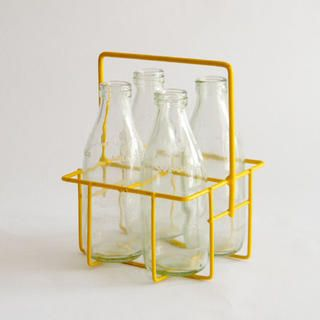 4 MILK BOTTLES & YELLOW CRATE $75