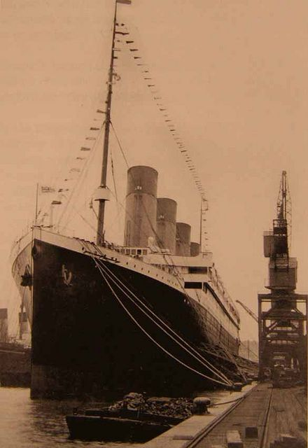 The Titanic docked in Southampton and dressed with flags on Good Friday 1912.: