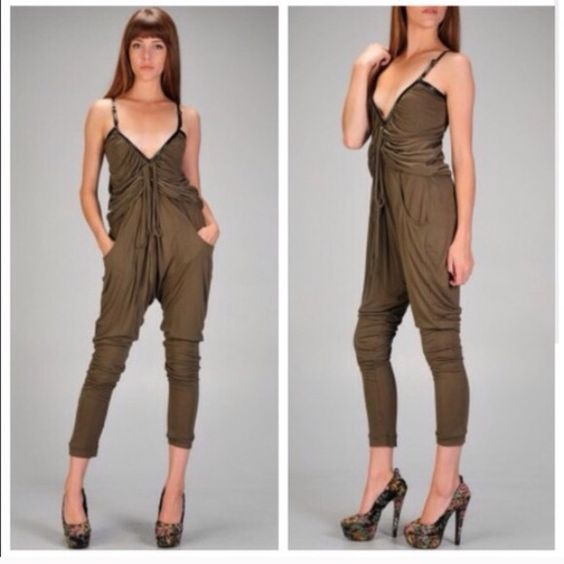 "Olive Green Jumpsuit Trending fall/winter color. Very cute. The way the front is designed, hides flaws such as a ""high"" tummy. Faux leather trim. Fabric is not not thick or thin it's somewhere in between. And it stretches. Front Pockets! Buckle for straps! Price is firm! Dresses"