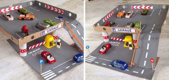 Parking de coches hecho con cajas de pizza y tubos de for Parking de coches