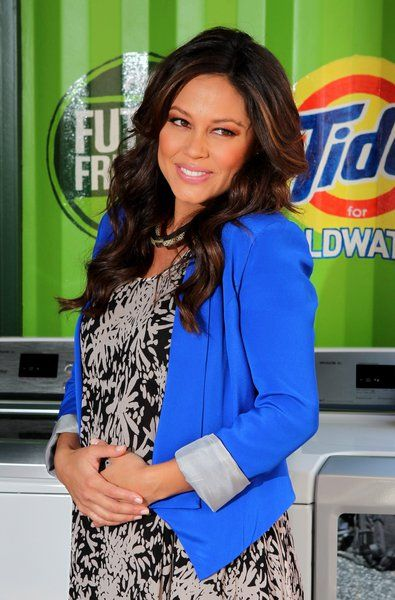 Vanessa Lachey cradles her baby bump as she attends the 'Take A Load' Off…