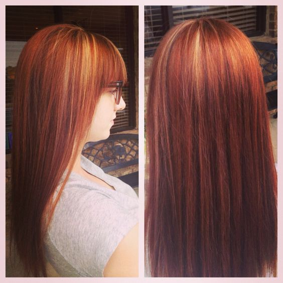 Red and blonde hair. Long hair. Bangs.