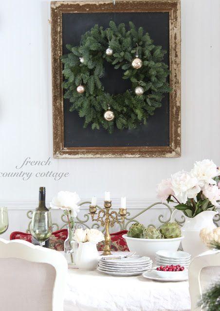 Great holiday decor idea with simple fresh green wreath on black framed chalkboard. #holidayinspiration #christmaswreath #farmhouseChristmas