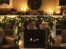 Christmas Decorated Fireplace - Love how the mantel extends over the bookcases.