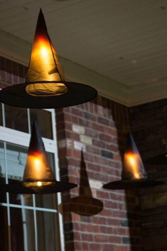 Clever decorating idea for Halloween, floating Witch's hat to create that Hogwarts look and feel.: