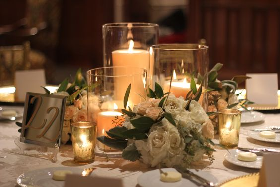 Some of the centerpieces will be trios taper candles in