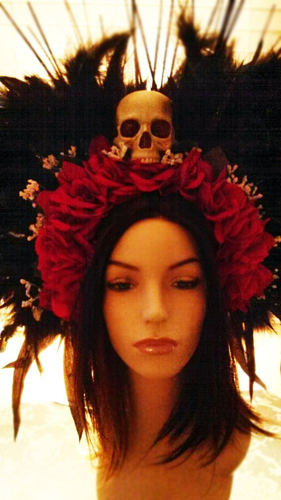 Voodoo headdress velvet red roses black feathers mixed with peacock feathers with skull and lights https://www.etsy.com/listing/218162556/voodoo-headdress-velvet-red-roses-black