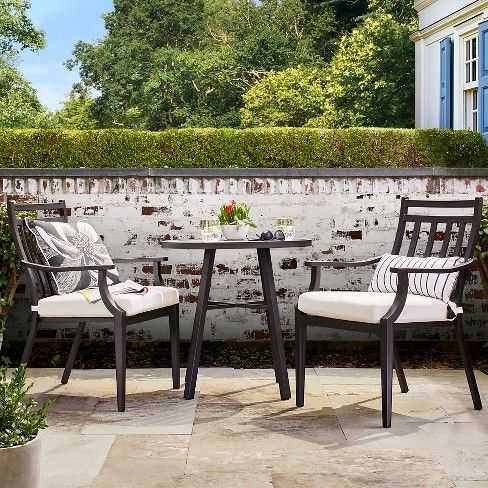 Bring the indoors outside with the 3-Piece Metal Patio Bistro Set from Threshold™. This casual and stylish outdoor dining set marries comfort and design. This set includes two cushioned armchairs and a round table so you can turn any outdoor space into your own personal bistro. The clean lines and tapered front legs add a detailed touch to the design of the chairs. Fitted with foam-filled cushions, these armchairs provide a comfortable seat that's made to last and sure to please....