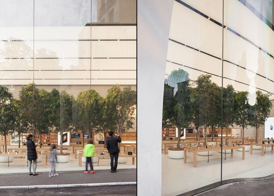 Light boxes extend the length of the ceiling, similar to those found in Foster + Partner's Apple Store in Hangzhou, China. Rows of the chunky tables made from sequoia wood present laptops, phones and tablets, while accessories are displayed inside a case that runs along the longest wall.