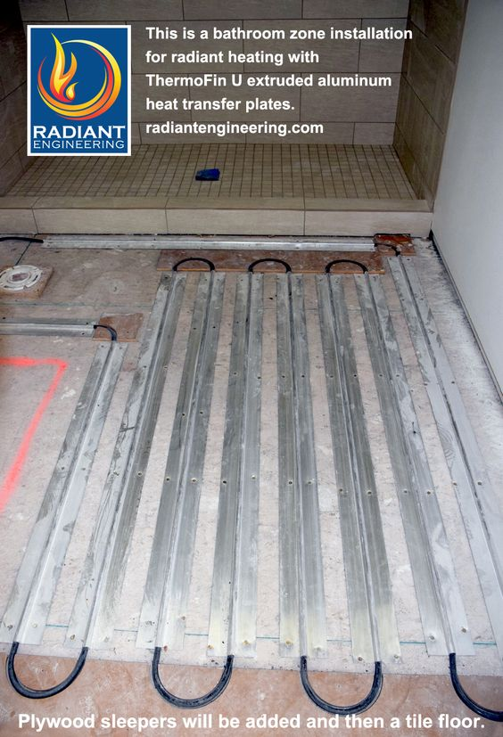 Web Photo Gallery This bathroom zone for radiant heating shows the installation of ThermoFin U extruded aluminum heat transfer plates PEX and return bends ready f u