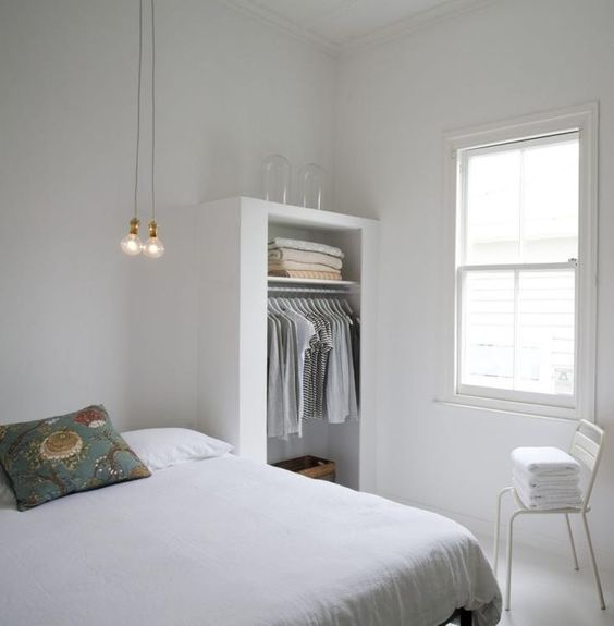 Another favorite clean-lined design by Claudia Zinzan of Father Rabbitfeatures a shallow open closet.#minimaldesign #whitebedroom #slowliving