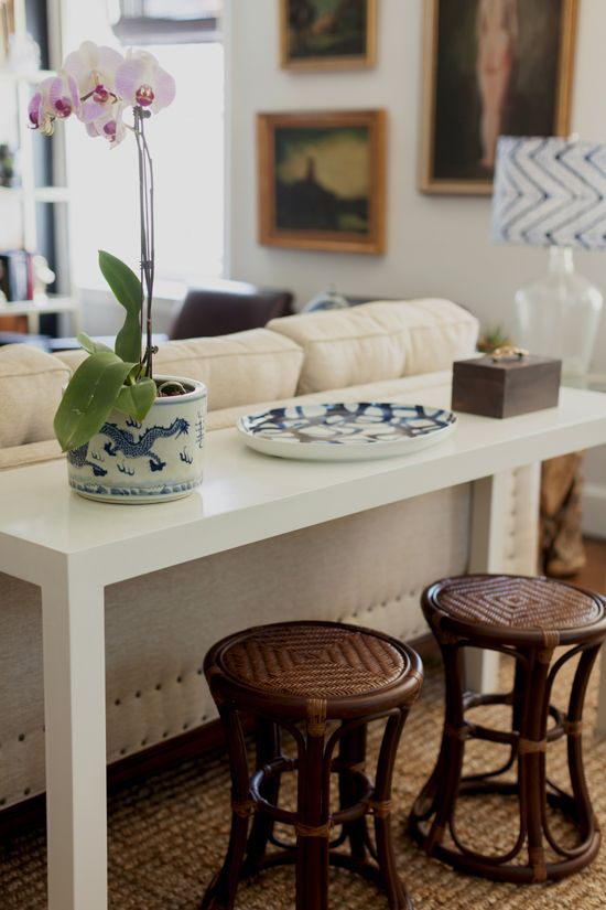 white parsons sofa table with rattan stools: