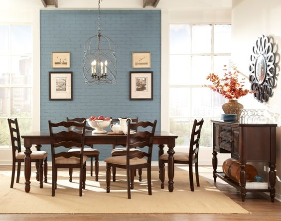 European country charm graces the Liberty Dining set with a Hickory wood fancy-face veneer pattern on the table top. Convenient self-storing table leaf makes family gatherings easier than ever! The matching side chair features shaped ladder back with turned front legs and upholstered cushioned seat.