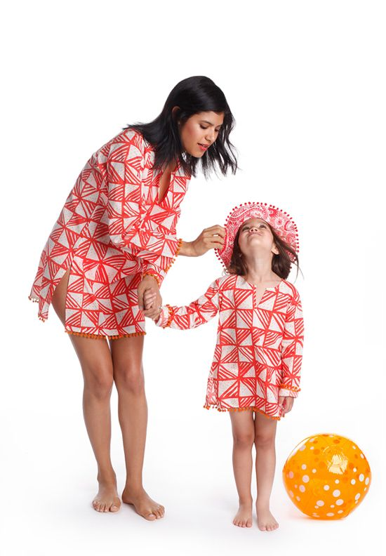 """How often do women say, """"I wish you made this in my size!"""" The Masala Baby design team hears the comment all the time. For spring-summer 2015, they've introduced a small collection of Mommy & Me Tunics. Whether you pop the top over jeans or a bathing suit, it never fails to look effortlessly chic. www.masalababy.com (designer preview)"""