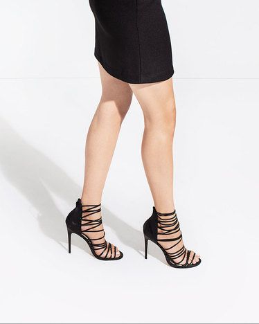 This super strappy silhouette serves up style in spades. In black leather.