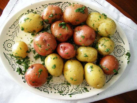 Steamed baby potatoes with parsley butter