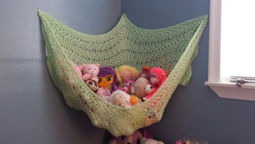 DIY stuffed animal hammock made out of an old blanket and hooks :-)