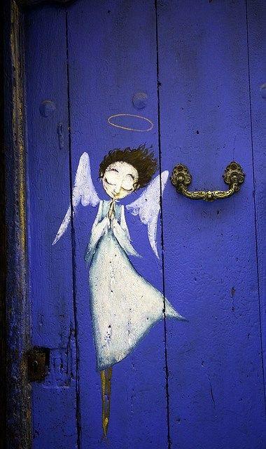 Angel on door.: