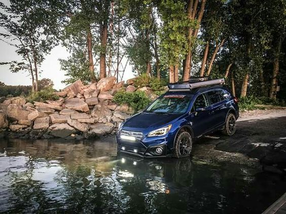 Subaru Outback entering water