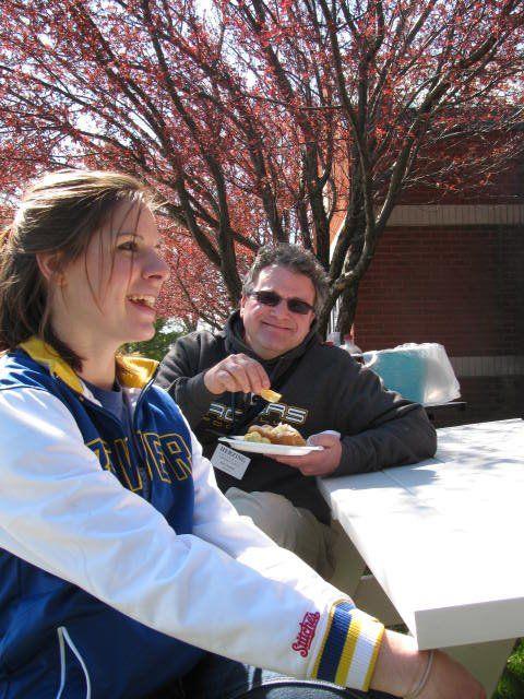 Molly Sylvester (Registrar) & Kert Acklam (English Instructor) grilling out at the Kenosha Campus.