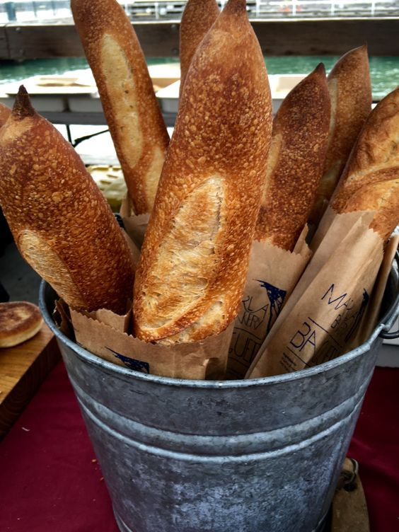 Clever display of baguettes at the Ferry Plaza Farmers Market in San Francisco! A wonderful market rich in variety--organic fruits and vegetables, local wines and olive oil, grass fed meats, artisan breads, and so much more!  Find healthy, delicious recipes at www.MarysLocalMarket.com Sustainable-Natural-Community #maryslocalmarket