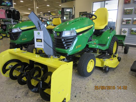 John Deere X590 equipped with 44 inch snowblower