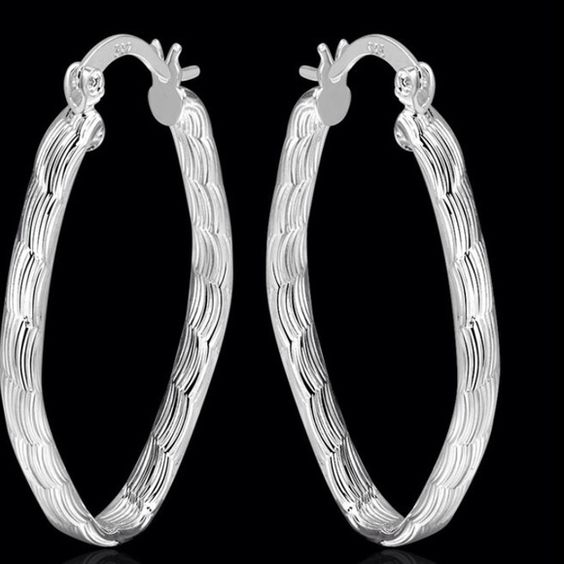 Oval .925 Sterling Silver Earrings. New. .925 Sterling Silver Stamped . Excellent durable Quality. Pierced earrings. Hoops.  Wave cut design. Bundle and save on already low prices! Jewelry Earrings