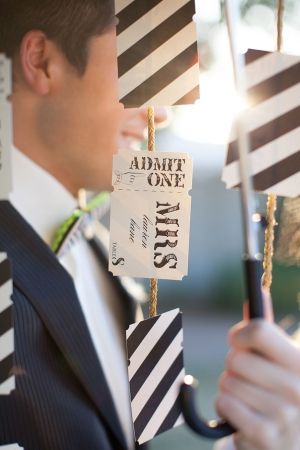 circus-inspired ticket seating cards - love the striped back // photo by Diane Elizabeth, event design by AngelaSabanDesign.com