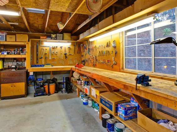 Rustic garage with concrete floors exposed beam built in for Design your own garage workshop