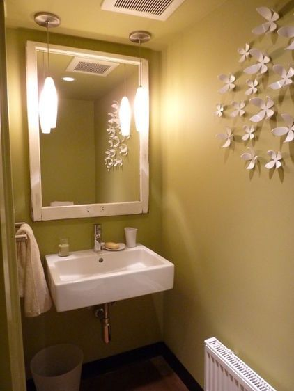 this cool green is good for the skin tone w the light. modern powder room by Motionspace Architecture   Design