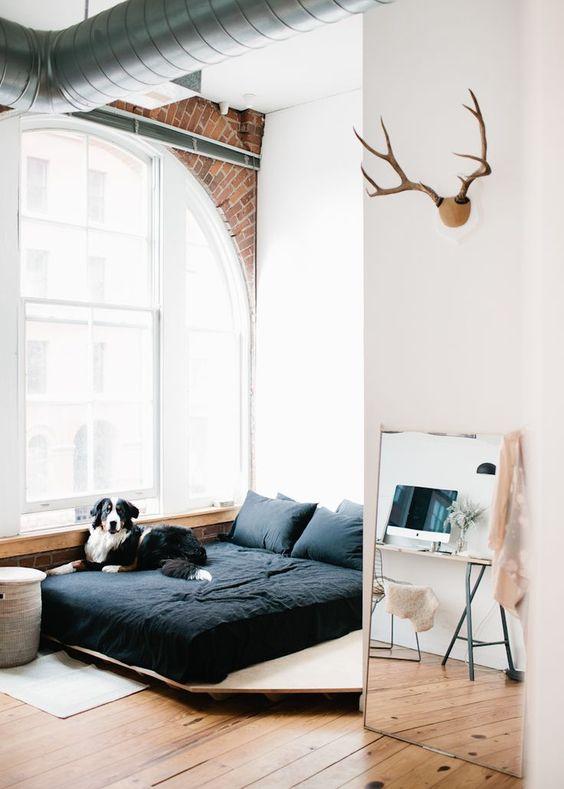 Dormitorio con estilo industrial.
