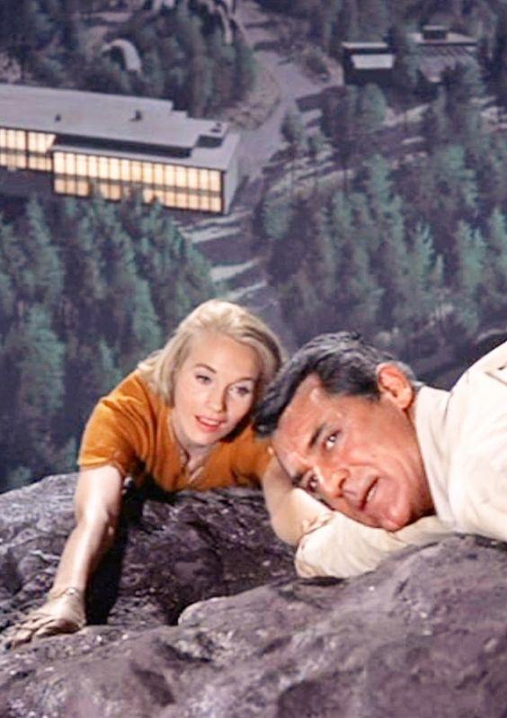 Eva Marie Saint & Cary Grant in a terrifying, cliff hanger scene in Alfred Hitchcock's, 'North by Northwest', 1959.