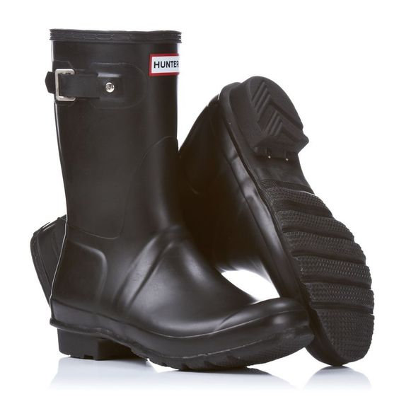 A pair of Hunter Original Short Wellington Boots in black, showing the sides and sole