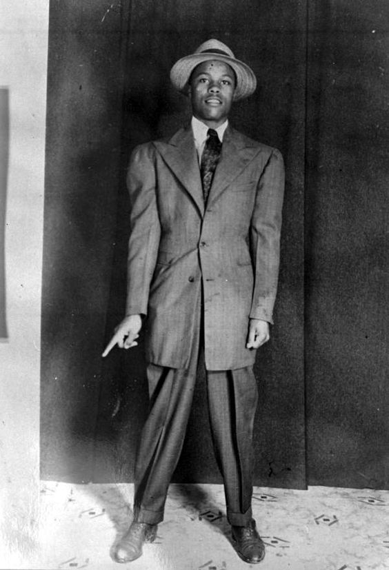 Zoot Suit-- consisted of a jacket that was long with excessively wide shoulders and long, wide lapels, and trousers that were markedly pegged
