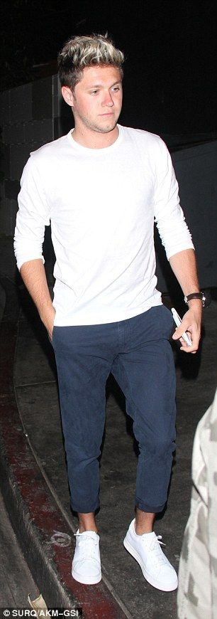 Stylish: Niall cut a more casual look, dressing in a white long sleeves T-shirt…