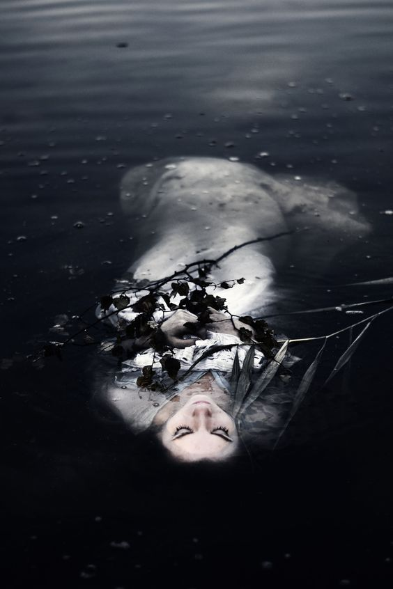 This is what I envisioned the people who found Ophelia would have saw in Act 4 Scene 7 when she drowned herself. Her skin would have been so pale and light and she would be floating among branches and leaves.: