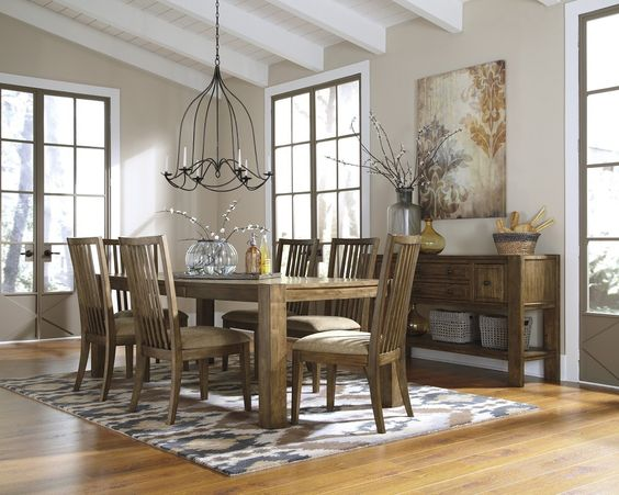 Wood grain table! & check out that Chandelier! Swoon. explore underpricedfurniture.com #wood #underpricedfurniture