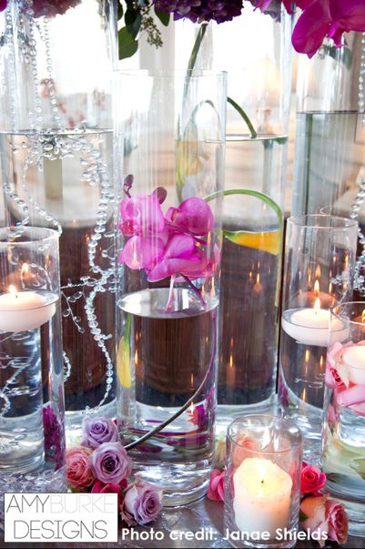 Submerged orchid and crystals with small roses directly on the table and floating candles. #unique @janaeshields
