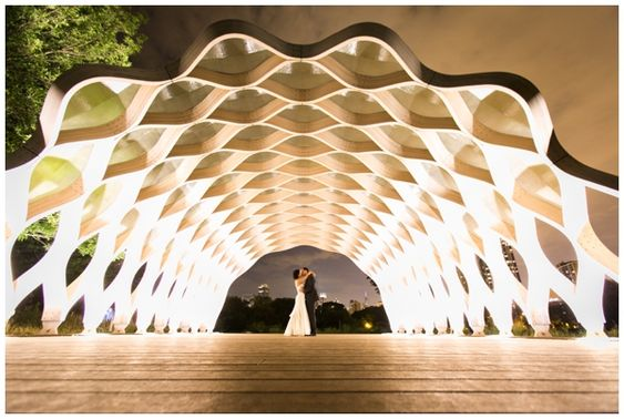 LINCOLN PARK ZOO SOUTH POND. Gorgeous archway - great wedding photos for day or night, up close or far away. Designed by Studio Gang Architects (famous for  Aqua) Wedding photoshoot ideas; wedding photography; Chicago wedding photo locations. #WeddingPhotos #WeddingPhotography