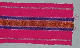Narrow-strip cloth sample (aso oke: 'cloth from up country'). Fuchsia cotton weft; warp design composed of fuchsia cotton, silver, blue and gold lurex stripes. This is an example of the recently-introduced wider cloth strips.
