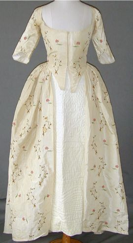 """Embroidered dress, English, c. 1774. Worn by descendants of Rev Thomas Hodges who married Mary Davies, born 1750 only daughter of Rev Henry Davies, in October 1783 at Eastington. The Hodges family had an unbroken lineage at Arlingham since the early 16th century. The dress must have been worn by Mary's daughter. This dress has a copy of the original bill dated 22 April 1774 and addressed to """"Miss Davis"""" from """"Jane Gadby & Co."""" It must have been worn by Mary Davies' mother (with a mistake in…"""